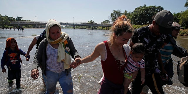 Westlake Legal Group AP20020660062215 Caravan migrants cross Mexico river, throw rocks at country's national guard in response to tear gas Louis Casiano fox-news/world/migrant-caravan fox-news/us/immigration/mexico fox-news/us/immigration/border-security fox-news/us/immigration fox-news/travel/regions/central-america fox news fnc/world fnc article 73781e86-755d-53e1-84dd-16a11ddf2293