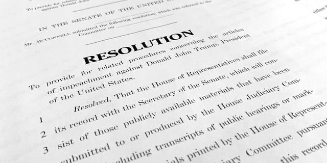 A copy of a Senate draft resolution to be offered by Senate Majority Leader Mitch McConnell, R-Ky., regarding the procedures during the impeachment trial of President Trump. (AP Photo/Jon Elswick)