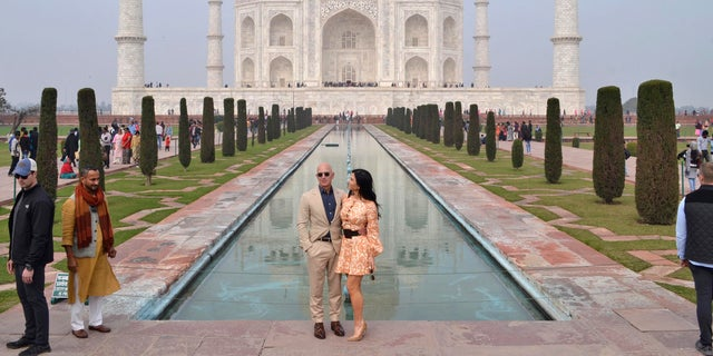 Amazon CEO Jeff Bezos and his partner Lauren S谩nchez stands for photographs in front of the Taj Mahal in Agra, India, Tuesday, Jan. 21, 2020. (AP Photo/Pawan Sharma)