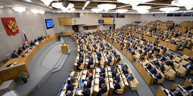 Russian lawmakers work during a session at the Russian State Duma, the Lower House of the Russian Parliament in Moscow, Russia, on Tuesday. (AP Photo/Alexander Zemlianichenko)