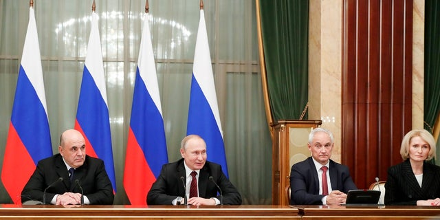 Russian President Vladimir Putin, second left, new Russian Prime Minister Mikhail Mishustin, left, former Putin's economic adviser Andrei Belousov, appointed as a first deputy Prime Minister, second right, and deputy Prime Minister Viktoria Abramchenko attend a new cabinet meeting in Moscow on Tuesday. Putin formed his new Cabinet Tuesday, replacing many of its members but keeping his foreign, defense and finance ministers in place. (Dmitry Astakhov, Sputnik, Government Pool Photo via AP)