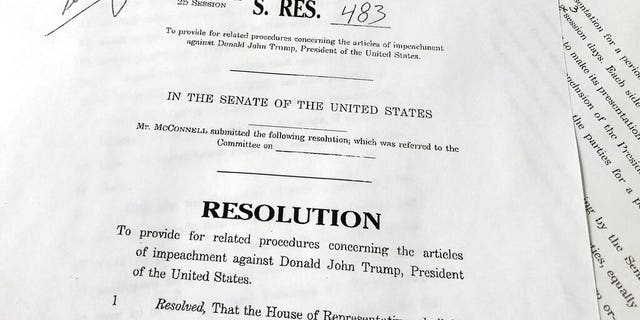 A copy of revised U.S. Senate Resolution 483, which provides procedures concerning the articles of impeachment against President Donald Trump, released Tuesday, Jan. 21, 2020 on Capitol Hill in Washington. Senate Majority Leader Mitch McConnell has abruptly changed his proposed rules for President Donald Trump's impeachment trial after some of his fellow Republican senators objected. (AP Photo/Wayne Partlow)