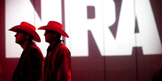 FILE: National Rifle Association members listen to speakers during the NRA's annual Meetings and Exhibits at the George R. Brown Convention Center in Houston.聽