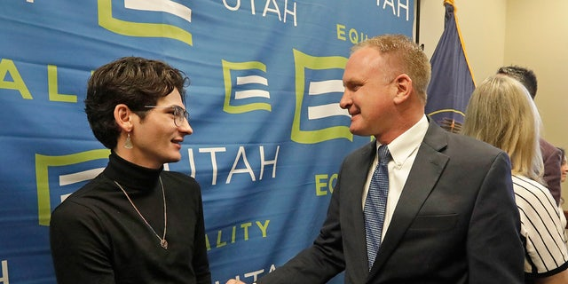 Nathan Dalley, left, shakes hands with Republican Utah Rep. Craig Hall following a news conference about the discredited practice of conversion therapy for LGBTQ children, now banned in Utah Jan. 22 at the Utah State Capitol. Dalley underwent so-called conversion therapy. (AP Photo/Rick Bowmer)