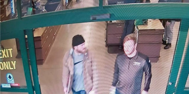 """This image from a Jan. 1, 2020, surveillance video and released in a U.S. attorney detention memorandum, shows Brian Mark Lemley Jr, right, and Patrik Mathews leaving a store in Delaware where they purchased ammunition and paper shooting targets. The pair, along with William Garfield Bilbrough IV, plotted to carry out """"essentially a paramilitary strike"""" at a Virginia gun rights rally, a federal prosecutor said Wednesday. (U.S. Attorney via AP)"""
