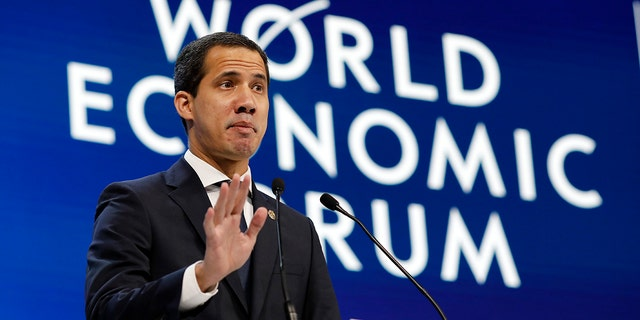 The leader of Venezuela's political opposition Juan Guaido addresses the World Economic Forum in Davos, Switzerland, Thursday, Jan. 23, 2020. The 50th annual meeting of the forum is taking place in Davos from Jan. 21 until Jan. 24, 2020. (AP Photo/Markus Schreiber)