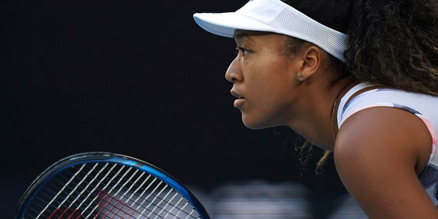 Japan's Naomi Osaka waits to receive serve from Coco Gauff of the U.S. during their third round singles match at the Australian Open tennis championship in Melbourne, Australia, Friday, Jan. 24, 2020. (AP Photo/Lee Jin-man)