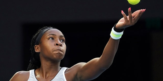 Coco Gauff of the U.S. serves to Japan's Naomi Osaka during their third round singles match at the Australian Open tennis championship in Melbourne, Australia, Friday, Jan. 24, 2020. (AP Photo/Lee Jin-man)