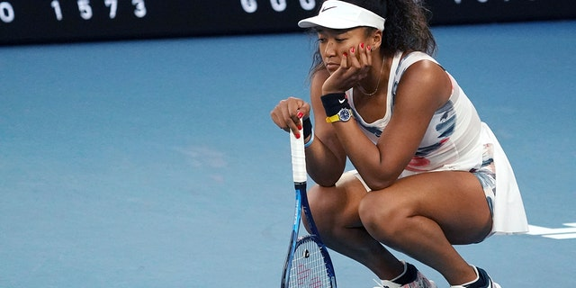 Japan's Naomi Osaka reacts during her third-round loss to Coco Gauff of the U.S. at the Australian Open tennis championship in Melbourne, Australia, Friday, Jan. 24, 2020. (AP Photo/Lee Jin-man)