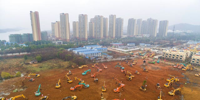 Heavy equipment at a construction site for a field hospital in Wuhan in central China's Hubei Province.