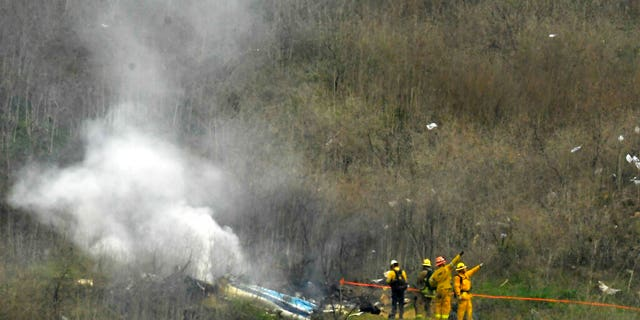 Firefighters working the scene of the helicopter crash where former Kobe Bryant died Sunday in Calabasas, Calif. (AP Photo/Mark J. Terrill)