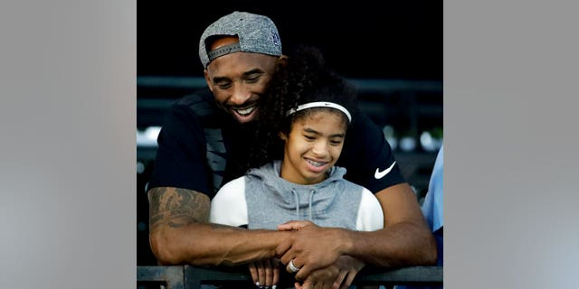 Kobe Bryant and his daughter Gianna at the U.S. national championships swimming meet in Irvine, Calif., in July 2018. (AP Photo/Chris Carlson, File)