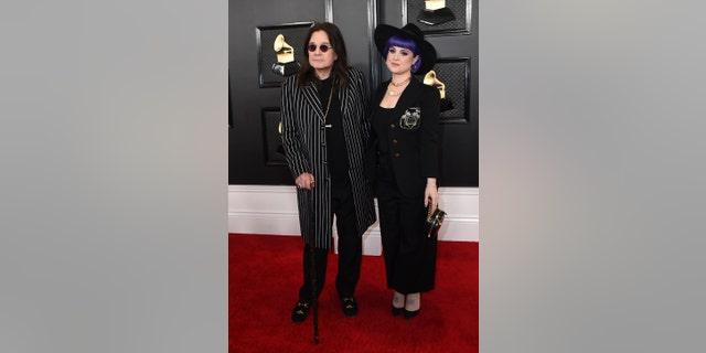Ozzy Osbourne, left, and Kelly Osbourne arrive at the 62nd annual Grammy Awards at the Staples Center on Sunday, Jan. 26.