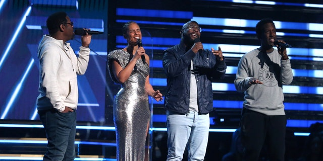 Nathan Morris, from left, Wanya Morris, Shawn Stockman, of Boyz II Men, and Alicia Keys, second left, sing a tribute in honor of the late Kobe Bryant at the 62nd annual Grammy Awards on Sunday.