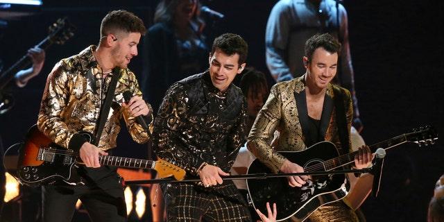 Nick Jonas, from left, Joe Jonas, and Kevin Jonas, of the Jonas Brothers, perform at the 62nd annual Grammy Awards on Sunday, Jan. 26, 2020, in Los Angeles.