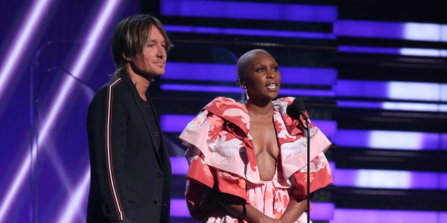 Keith Urban, left, and Cynthia Erivo present the award for best pop solo performance at the 62nd annual Grammy Awards on Sunday, Jan. 26, 2020, in Los Angeles.