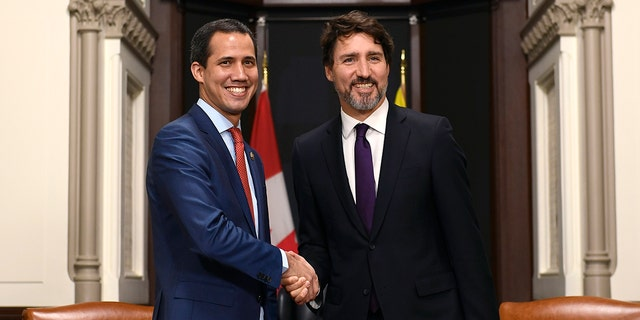 Canada's Prime Minister Justin Trudeau, right, and interim President of Venezuela Juan Guaido shake hands before a meeting at Trudeau's Parliament Hill office in Ottawa, Ontario, Monday, Jan. 27, 2020. (Justin Tang/The Canadian Press via AP)