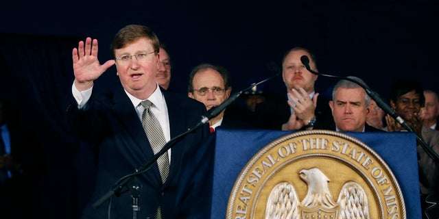 Gov. Tate Reeves waves to the audience after delivering his State of the State address before a joint session of the Legislature, outside the Capitol in Jackson, Miss., on Monday. (AP Photo/Rogelio V. Solis)