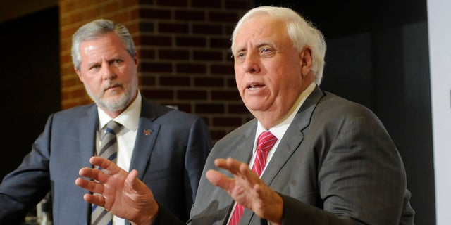 Jerry Falwell Jr., President of Liberty University, and Jim Justice, Governor of West Virginia, answer questions at a press conference at Blue Ridge Community and Technical College on Tuesday in Martinsburg, W.Va. (Ron Agnir/The Journal via AP)