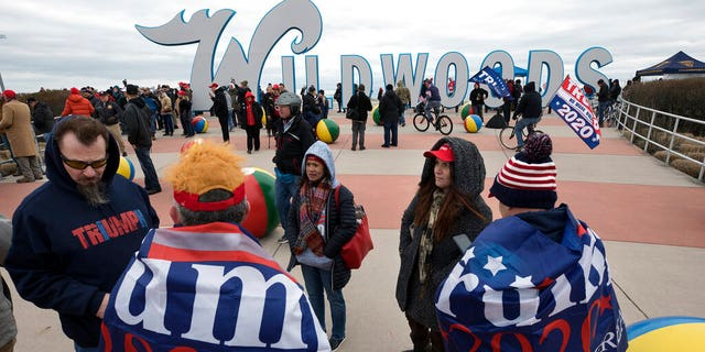 Supporters of President Trump supporters in a crowd near the iconic Wildwoods sign Tuesday. (AP Photo/Mel Evans)