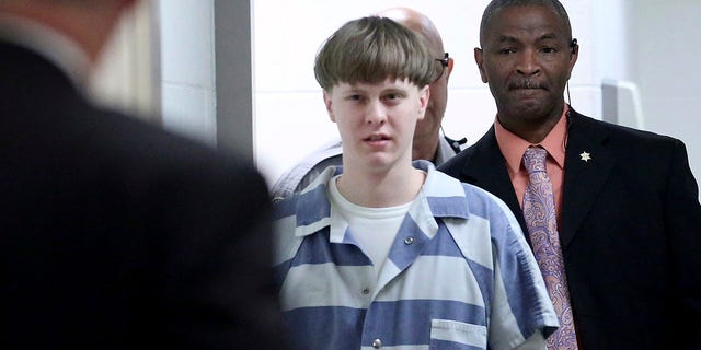 FILE - In this April 10, 2017, file photo, Dylann Roof enters the courtroom at the Charleston County Judicial Center to enter his guilty plea on murder charges in Charleston, S.C. White supremacist Roof on Tuesday, Jan. 28, 2020, appealed his federal convictions and death sentence in the 2015 massacre of nine black church members in South Carolina, arguing that he was mentally ill when he represented himself at his capital trial. (Grace Beahm/The Post And Courier via AP, Pool, File)