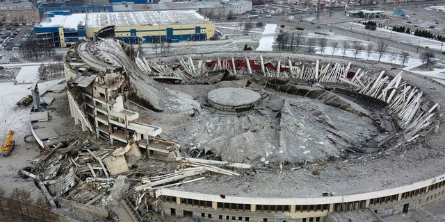 A view of stadium, sports and concert complex Petersburgsky, collapsed during disassembly of the roof in St.Petersburg, Russia on Friday. The Peterburgsky stadium, one of the biggest stadiums in Europe, had been built for the 1980 Moscow Olympics and was being converted into an ice hockey arena for the 2023 IIHF World Championship. (AP Photo/Dmitri Lovetsky)