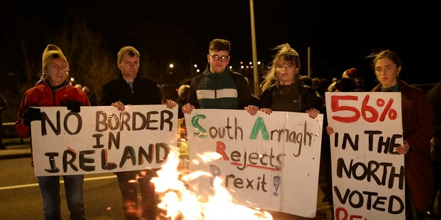 Protesters from the campaign group Border Communities Against Brexit take part in a demonstration in Carrickcarnon on the Irish border, Ireland on Friday. (AP Photo/Peter Morrison)