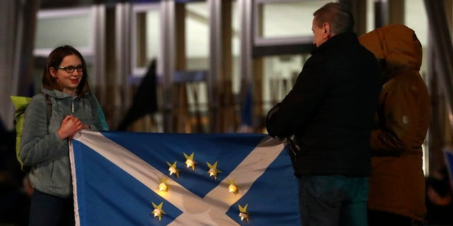 Anti-Brexit protesters gather outside the Scottish parliament in Edinburgh.<br> Britain officially leaves the European Union on Friday after a debilitating political period that has bitterly divided the nation since the 2016 Brexit referendum. (AP Photo/Scott Heppell)