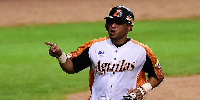 Alex Romero of Aguilas del Zulia from Venezuela celebrates after scoring against Alazanes de Granma from Cuba during their Caribbean Baseball Series at the Tomateros stadium in Culiacan, Sinaloa State, Mexico, on Feb. 4, 2017. (RONALDO SCHEMIDT/AFP via Getty Images)