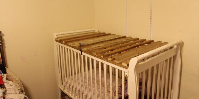 The two cages appeared to each have a mattress and blanket inside.