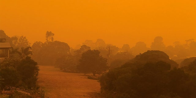 The sky glows orange as surrounding wildfires close in on the town of Mallacoota, Victoria, Australia, January 4, 2020, in this photo obtained from social media.