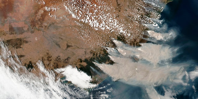 This satellite image provided by NASA on Saturday, Jan. 4, 2020 shows wildfires in Victoria and New South Wales, Australia.