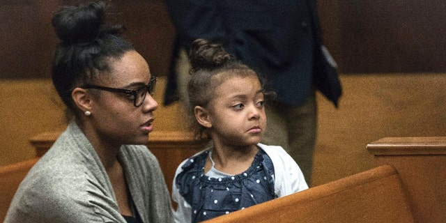 Shaynna Jenkins and her daughter Avielle at a court appearance for Aaron Hernandez in 2017.