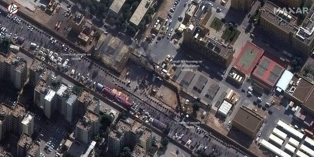 Satellite image of the crowd at the Eastern entrance to the U.S. Embassy compound in Baghdad rally. 1,2020 years.