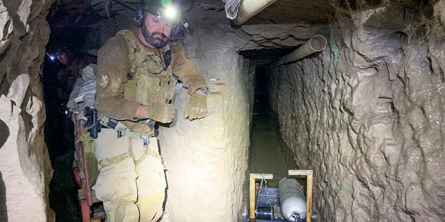 A tunnel entry team agent stands by for security at a tunnel spur that went off into a different direction.