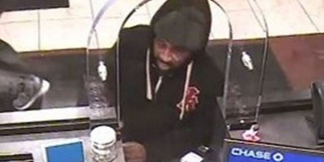 Cops have identified the person in this image as accused bank robber Gerod Woodberry, 42. Woodberry turned himself in to authorities Friday. His release prompted criticism of a bail reform law that led to his earlier release. (New York City Police Department)