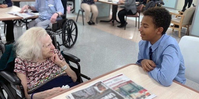 Hildegard, 94, talks with New York City middle schooler Basti Williams. The two became friends through their shared German heritage.