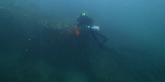 Diver Joe Citelli inspecting the SS Cotopaxi shipwreck.
