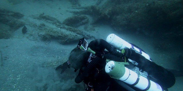 Michael Barnette searching for clues on the SS Cotopaxi wreck.