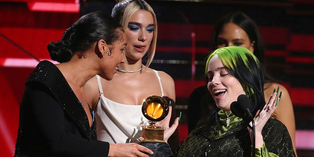 Alicia Keys, from left, and Dua Lipa present Billie Eilish with the award for best new artist at the 62nd annual Grammy Awards on Sunday, Jan. 26, 2020, in Los Angeles. (Photo by Matt Sayles/Invision/AP)