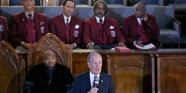 Presidential candidate Michael Bloomberg speaking during a service at the Vernon American Methodist Episcopal Church in Tulsa on Sunday, as the Rev. Robert Turner looked on. (AP Photo/Sue Ogrocki)