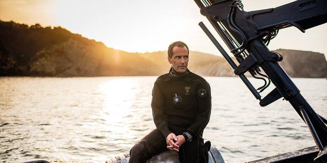 Borja Saracho, the owner of Crusoe Treasure, sits in his boat Capitania Maritima.