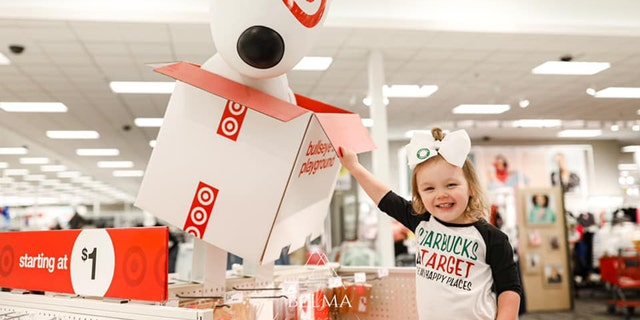 """In the series of sweet pictures, the jubilant birthday girl rocked a custom T-shirt that read """"Starbucks and Target are my happy places."""""""