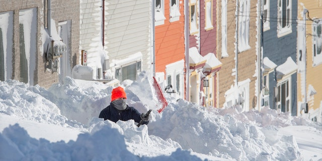 A resident digs out his walkway in St. John's Newfoundland on Saturday, Jan. 18, 2020.