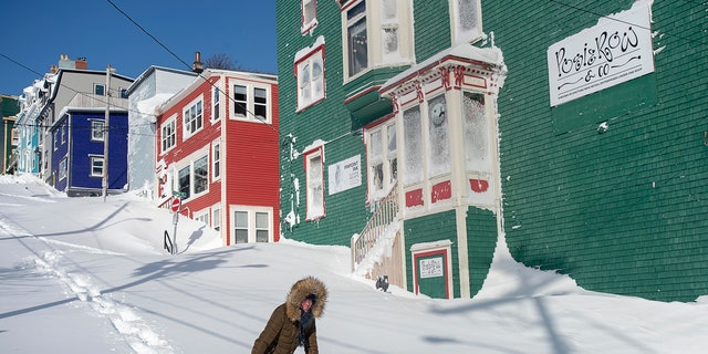 A resident makes their way through the snow in St. John's, Newfoundland on Saturday after a major blizzard hit the area.