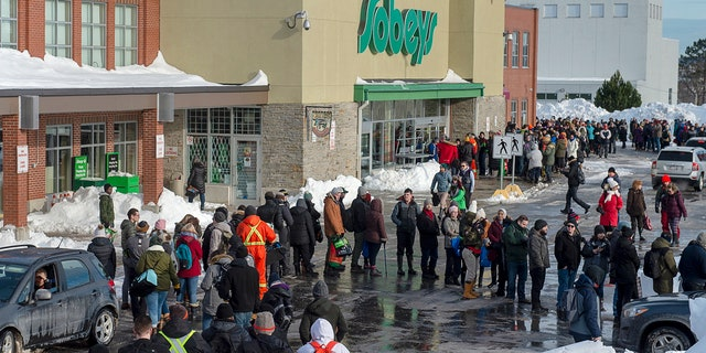 Customers line up at a Sobeys grocery store in St. John's, Newfoundland, Tuesday, Jan. 21, 2020.
