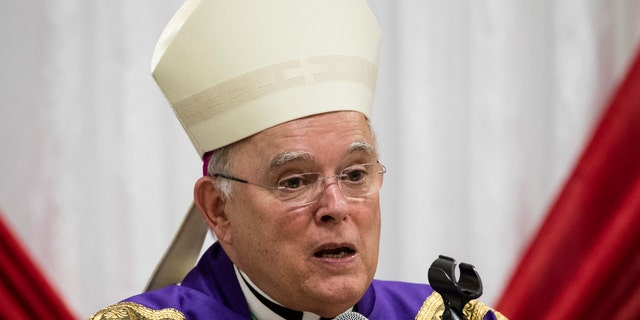 FILE - In this Dec. 18, 2017, file photo, Philadelphia Archbishop Charles Chaput celebrates Mass with inmates at the Curran-Fromhold Correctional Facility in Philadelphia. The Vatican announced Thursday, Jan. 23, 2020, Chaput, who will step down after turning 75 last year, the traditional retirement age for Catholic bishops, will be replaced by bishop of Cleveland Nelson Perez. (AP Photo/Matt Rourke, File)