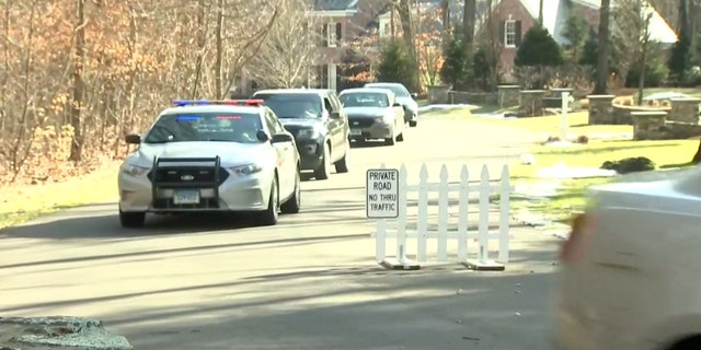 US News Law enforcement can be seen at the home of Fotis Dulos, the estranged husband of long-missing Connecticut mother of five Jennifer Dulos.