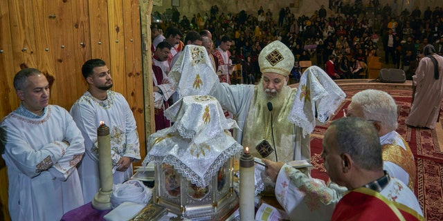 Coptic Christians attend Christmas eve mass at Saint Saman church in eastern Cairo, Egypt. Monday, Jan. 6, 2020. (AP Photo/Hamada Elrasam)