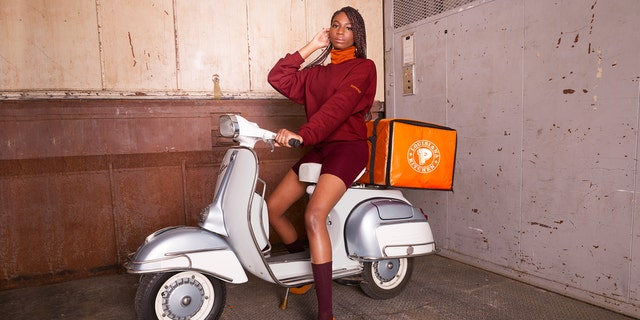 """Popeyes has taken it upon itself to offer its own ten-item collection that features """"some of the brand's most iconic maroon and orange uniform designs."""""""